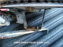 water heater orifice located under the burner